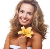 Young beautiful woman with flower Royalty Free Stock Photos