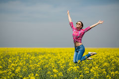 Young beautiful woman in flowering field in summer. Outdoors Royalty Free Stock Image