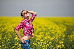 Young beautiful woman in flowering field in summer. Outdoors Stock Photos