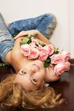 Young beautiful woman with flowers Stock Image