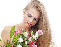 Young beautiful woman with flowers Royalty Free Stock Photos