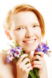 Young beautiful woman with flowers Royalty Free Stock Image