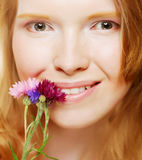 Young beautiful woman with flowers Stock Images
