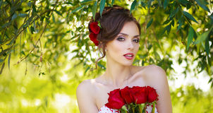 Young beautiful woman. With flowers in hair Royalty Free Stock Photography