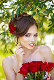 Young beautiful woman. With flowers in hair Royalty Free Stock Photos