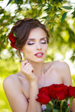 Young beautiful woman. With flowers in hair Royalty Free Stock Image