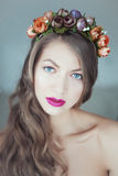 Young beautiful woman with flowers in hair and blue eyes Royalty Free Stock Photo