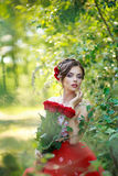Young beautiful woman. With flowers outdoor Stock Photography