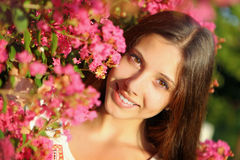 Young beautiful woman in flowers Stock Images
