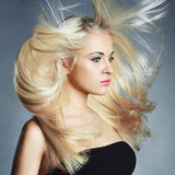 Young beautiful woman. Flying hair Blond girl Royalty Free Stock Image