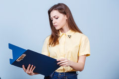 Young beautiful woman with folder Royalty Free Stock Images