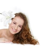 Young beautiful woman with fresh flower in hair royalty free stock image