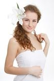 Young beautiful woman with fresh flower in hair royalty free stock photography