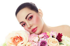 Beautiful woman with fresh make-up and flowers over white royalty free stock photography