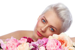 Young beautiful woman with fresh make-up and flowers over white royalty free stock photo