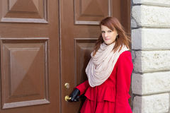 Young beautiful woman in front of the old door Stock Images