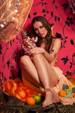 Young beautiful woman with fruit. Stock Photography