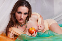 Young beautiful woman with fruit. Stock Photos