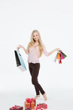 Young beautiful woman in a full-length with shopping bags Stock Photos