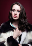 Young beautiful woman in fur coat and with green pistachio colou Stock Photo