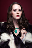 Young beautiful woman in fur coat and with green pistachio colou Royalty Free Stock Photography
