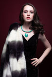 Young beautiful woman in fur coat and with green pistachio colou Royalty Free Stock Photo