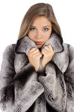 Young beautiful woman in a fur coat in profile stock photo