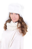 Young beautiful woman in fur hat isolated on white. Background Stock Photo