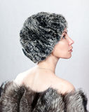 The young beautiful woman in a fur hat.Portrait Royalty Free Stock Photo