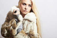 Young beautiful woman in fur. winter style.pretty girl. Beauty blond Model Girl in Mink Fur Coat Royalty Free Stock Photography
