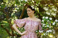 Young beautiful woman in the garden stock photography
