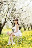 Young beautiful woman in garden Royalty Free Stock Photo