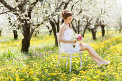 Young beautiful woman in garden Royalty Free Stock Photos