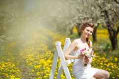 Young beautiful woman in garden Stock Images