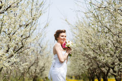 Young beautiful woman in garden Royalty Free Stock Photography