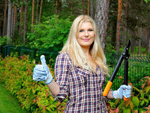 Young beautiful woman gardening and trimming Stock Images