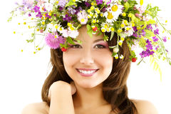 Young beautiful woman with garland of field fresh natural wild f Royalty Free Stock Photo