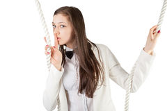 Young beautiful woman gesturing to silence. Young attractive businesswoman with rope shows keep a silence gesture Royalty Free Stock Photo