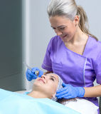 Young beautiful woman gets professional skin treatment in a beauty clinic. Beautiful women gets professional skin treatment in a beauty clinic Stock Image