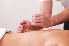 Young beautiful woman getting back massage Royalty Free Stock Photography