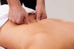 Young beautiful woman getting back massage Stock Photo