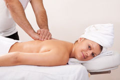 Young beautiful woman getting back massage Stock Image