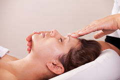 Young beautiful woman getting facial massage Stock Image