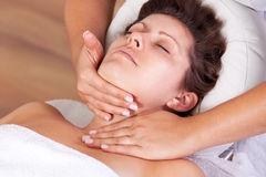 Young beautiful woman getting facial massage Royalty Free Stock Images