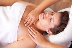 Young beautiful woman getting shoulders massage Royalty Free Stock Photo