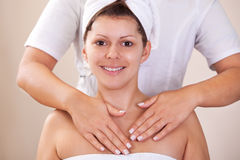Young beautiful woman getting shoulders massage Royalty Free Stock Image