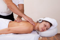 Young beautiful woman getting spine massage Stock Photos