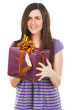 Young beautiful woman with a gift box Royalty Free Stock Images