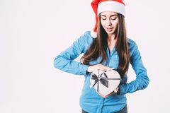 Young beautiful woman with gift box in shape of heart, isolated. Celebrating New Year and Christmas Stock Photography
