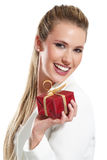Young beautiful woman with a gift. On a white background Royalty Free Stock Images